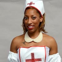 Studio portrait of Louise, a member of Elimu Carnival Band. She is in the costume of a nurse.