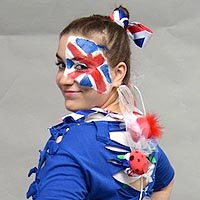 Nina-O with Union Jack makeup and a blue top.