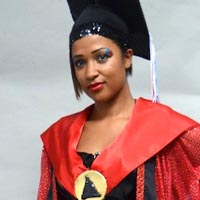Rhianna wearing mortar board and a red cape over a black corset.
