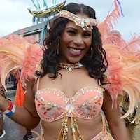 Dancer with pink bikini decorated with beads and ornate feathered headdress