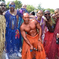 Members of Elimu taking a photo in colourful ribbons-costumes, together.