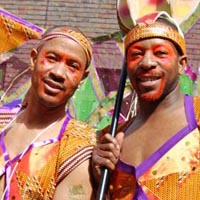 Two members of Elimu, dressed as latin american natives, as a part of the carnival parade.
