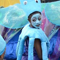 Members of Elimu dressed as blue octopus or jellyfish waiting for their performance.