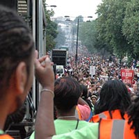 The photograph is showing the huge crowd, that want to be a part of the Notting Hill Carnival.