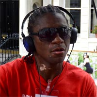 Nicky with black headphones and red T-shirt dancing at Notting Hill Carnival with Eldora