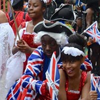 Members of Elimu wearing costumes with the Union Jack on it, or are dressed in white and red.