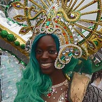Elaborate and ornated heae piece decirated with green rhinestones and sequins