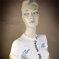 "Photo of Elimu T-shirt on a mannequin. The T-shirt is white and has a maritime design including waves and bubbles and a ""Tout Baggaie La Mer"" logo on the front."