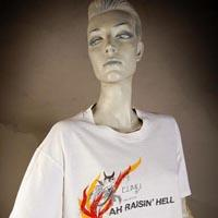 "Photo of Elimu T-Shirt on a mannequin. The T-Shirt is white with a devil on the top of flames and has a ""Ah Raising Hell"" logo on the front."