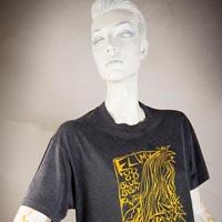 """Photo of Elimu T-shirt on a mannequin. The T-shirt is blue and has a yellow design showing a waterfall and entitled """"Blue Basin Fantasy"""" on the front."""