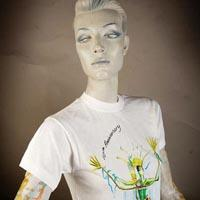 Photo of Elimu T-Shirt on a mannequin. The T-Shirt is white and has a design including a colourful figure on the front.