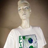 "Photo of Elimu T-shirt on a mannequin. The T-shirt is white and has a blue and green design including plants and entitled ""Inferno Verde"" on the front."