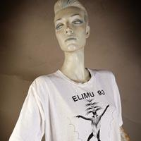 "Photo of Elimu T-Shirt on a mannequin. The T-Shirt is white with a person dancing and has a ""Night and Day"" logo on the front."
