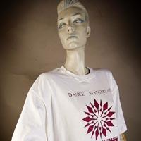 "Photo of Elimu T-Shirt on a mannequin. The T-Shirt is white and has a ""Dance Mandalas"" logo and a red mandala-flower on the front."