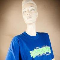 "Photo of Elimu T-shirt on a mannequin. The T-shirt is blue and has a green inscription and a ""Warpspeed the Millenium"" logo on the front."