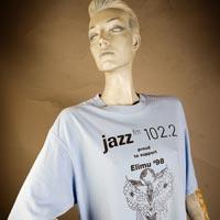 "Photo of Elimu T-shirt on a mannequin. The T-shirt is light blue and has a ""Changing Times"" logo on the front."