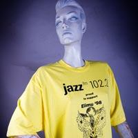 "Photo of Elimu T-Shirt on a mannequin. The T-Shirt is yellow and has a ""Changing Times"" logo on the front."