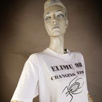 "Photo of Elimu T-Shirt on a mannequin. The T-Shirt is white with a spider and has a ""Changing Times"" logo on the front."