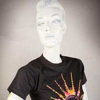 "Photo of Elimu T-shirt on a mannequin. The T-shirt is black and has a yellow and pink radial design entitled ""Dinshuru 2004"" and a ""Masala"" logo on the front."