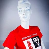 "Photo of Elimu T-Shirt on a mannequin. The T-Shirt is red with black, white & red designes on it. It has a ""Routes to Freedom"" logo on the front."