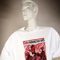 """Photo of Elimu T-shirt on a mannequin. The T-shirt is white and has a red and black rectangular design showing three women and a """"Canboulay"""" logo on the front."""