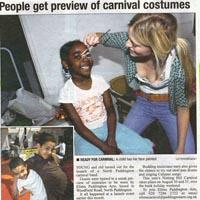 Press cutting about the possibility to take a look behind the scene of Elimu. Two pictures of children having their faces painted are added.