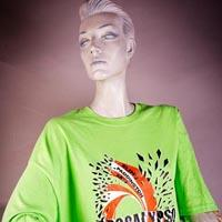 "Photo of Elimu T-Shirt on a mannequin. The T-Shirt is green with a spinning top design in the middel and has a ""Apocalypso"" logo on the front."