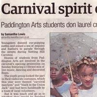 Press cutting about the Paddington Arts students and Elimu taking part at the Carnival. A photo of them is added.
