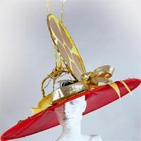 Big red hat with golden details and a huge golden pane on the top.