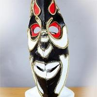 Africa inspired long and sharply shaped mask coloured in white, black and red with golden lines along the edges.