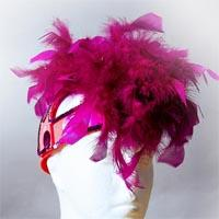 Red helmet covered by pink feathers.