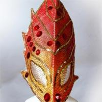 Red to orange mask, sharply shaped, coverd in a golden mesh, with red buttons and golden lines.